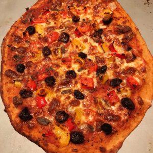 pizza full on baking tray
